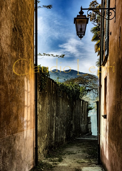 Alley to Orta Lake, Italy - This alley is one of the picturesque alleyways that a person can walk to go from the beautiful historical center of the village of Orta S.Giulio to the the coast of the Orta Lake.  The Orta Lake is a quite small lake in the Piedmont region in the North Italy.
